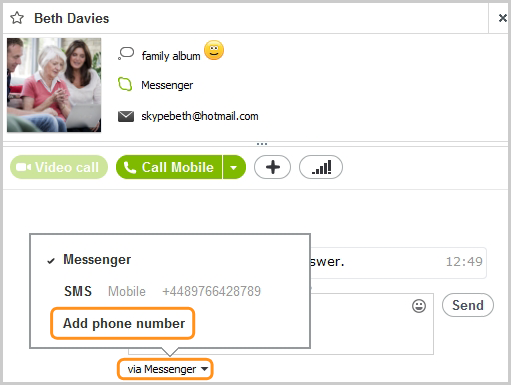 The Add phone number option selected from the list under the conversation box.